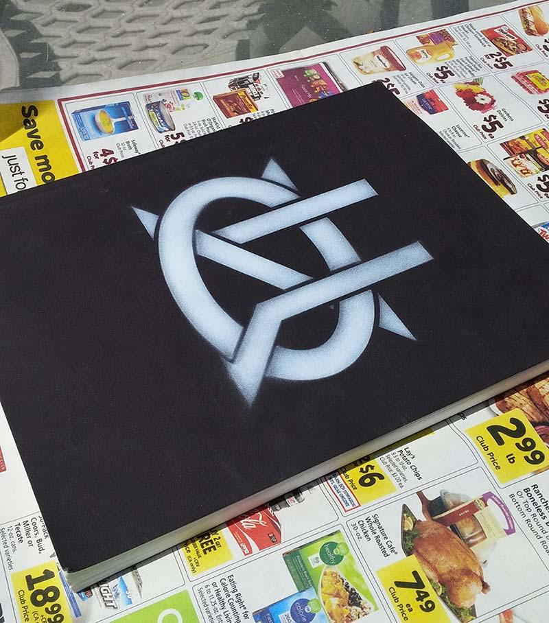 Spraypainted sketchbook cover.